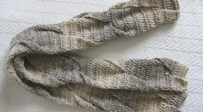 Crochet scarf with twist pattern and subtle color changes in the brown/gray family